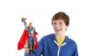 A boy holding MARVEL AVENGERS MIGHTY STRIKE THOR