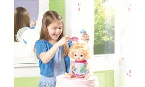 Little girl brushing BEAUTIFUL NOW BABY doll's hair.