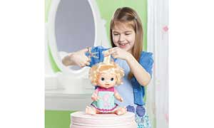 Little girl cutting BEAUTIFUL NOW BABY doll's hair.