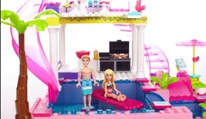 Barbie and Ken catching some sun pool side