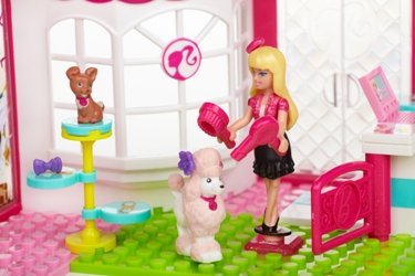 Barbie brushing her lovely poodle