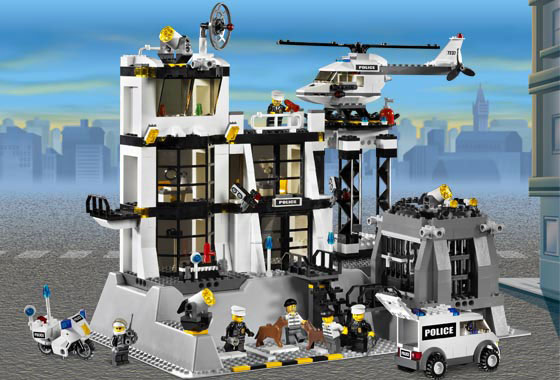 The LEGO Police Station includes a helicopter, van, and motorcycle