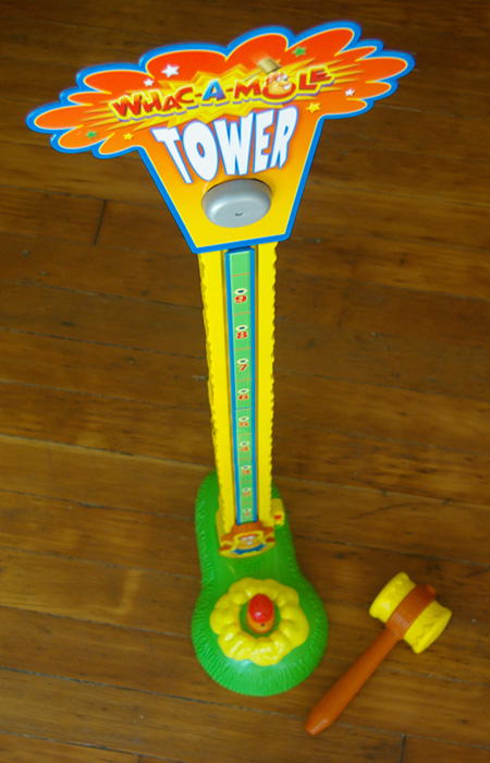 Whac-A-Mole Tower is a miniature version of the popular carnival game