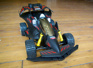 The Cyclone Remote Control Car features an aerodynamic design mixed with durability of an off-road dune buggy