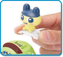 Slide Gotchi Figures onto your Tama-Go