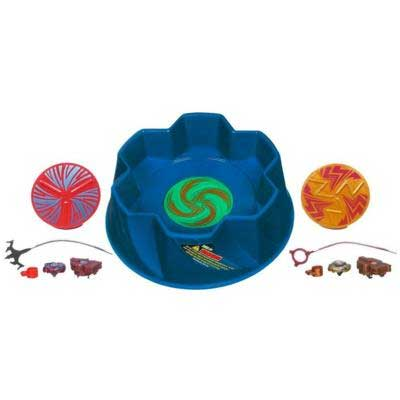 Two classic Beyblade tops spin and battle in the unique arena. View