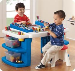 Smooth, plastic table offers generous work area and storage compartments.