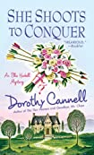 She Shoots to Conquer by Dorothy Cannell