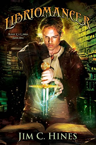 Libriomancer - Jim C Hines - a blonde guy in a library with a glowing sword thrust into a book in front of him. 
