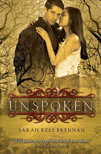 UK Cover: a gold tinted photo of a young man staring at the reader with an Asian girl whispering in his ear with bare trees in the background