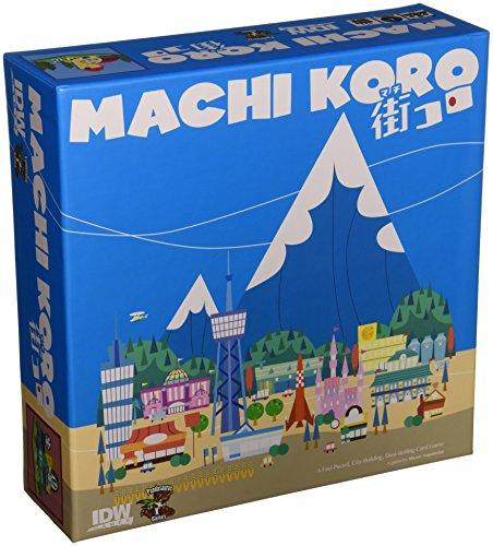 Cover Art shows a small city in front of a snow capped mountain. Cover text says Machi Koro