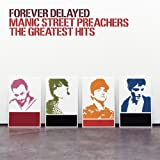 Skivomslag för Forever Delayed: The Greatest Hits (bonus disc: The Remixes)