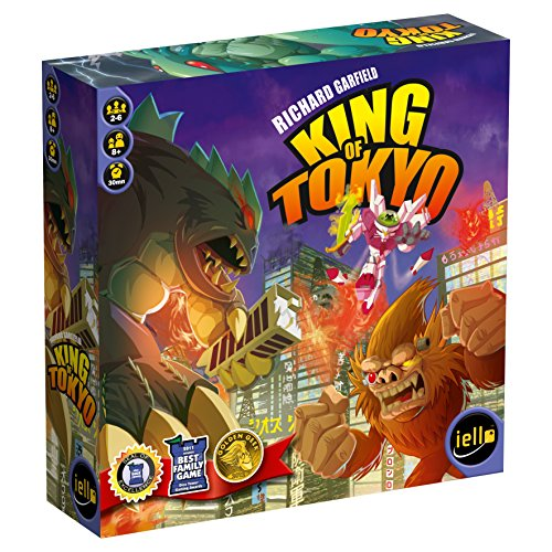 Cover Art shows Godzilla fighting King Kong and a Cyber Bunny in a city. Text says; Richard Garfield. King of Tokyo.