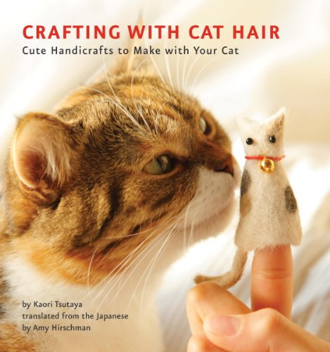 Book Crafting with cat hair - a cat nuzzling a finger puppet ostensibly made of his hair