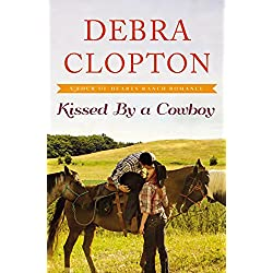 Kissed by a Cowboy (A Four of Hearts Ranch Romance)