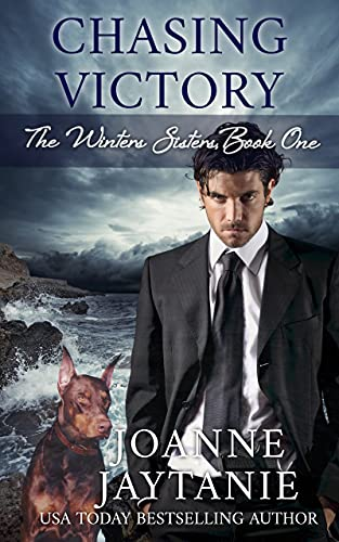 Chasing Victory by Joanne Jaytanie. The cover is almost neon blue with a double helix DNA strain in the middle. On the top half of the cover are a translucent man and woman. In the bottom left corner is a Doberman Pinscher.
